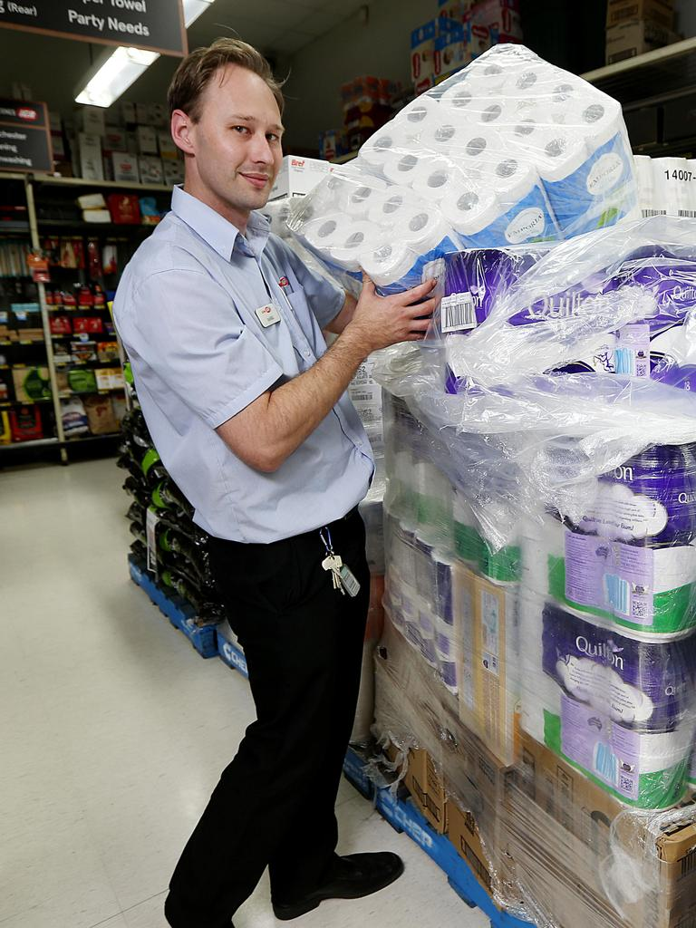 Assistant Manager of IGA Pease Street Daniel Oliver unpacks a pallet loads of toilet paper. Picture: Stewart McLean