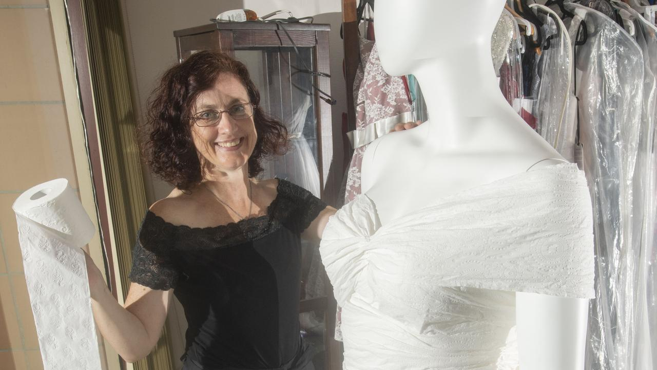 Leah Stevenson of Lasting Impression Bridal shows off her latest wedding gown, made entirely from toilet paper.