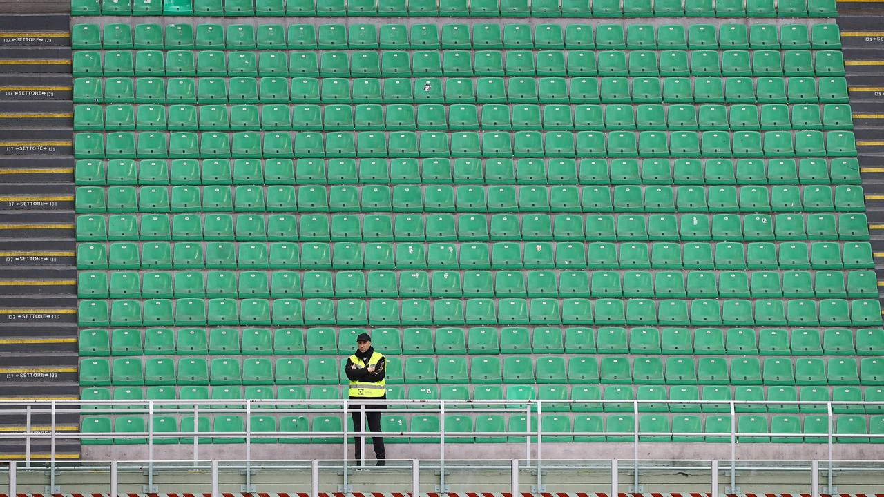 A steward looks on from an empty stand during the Serie A match between AC Milan and Genoa CFC in Milan. Picture: Getty Images