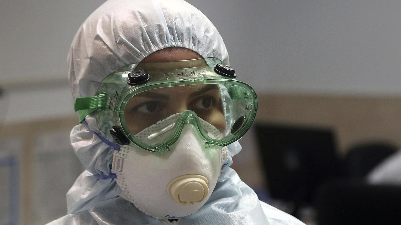 A nurse wears protective gear in a ward dedicated for people infected with the new coronavirus at a hospital in Tehran, Iran. Picture: Mohammad Ghadamali/AP