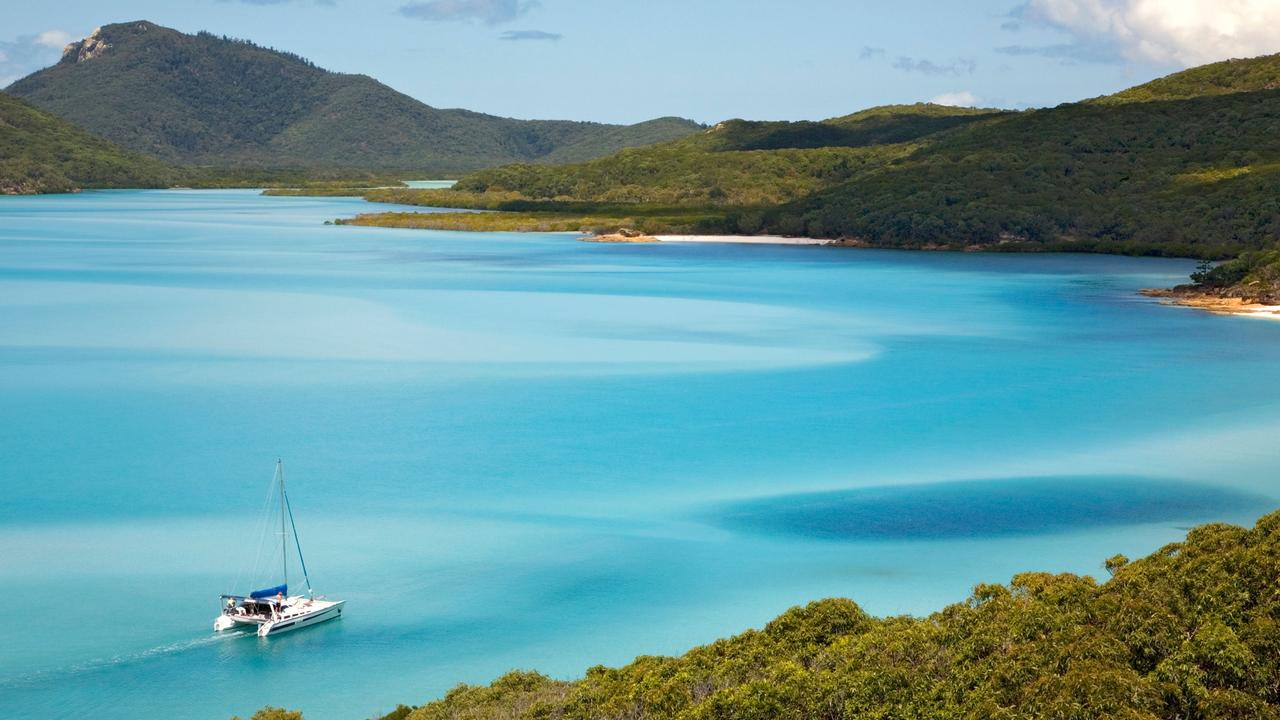 Explore the wonders of Whitehaven Beach with these cruising deals. Photo: Alamy