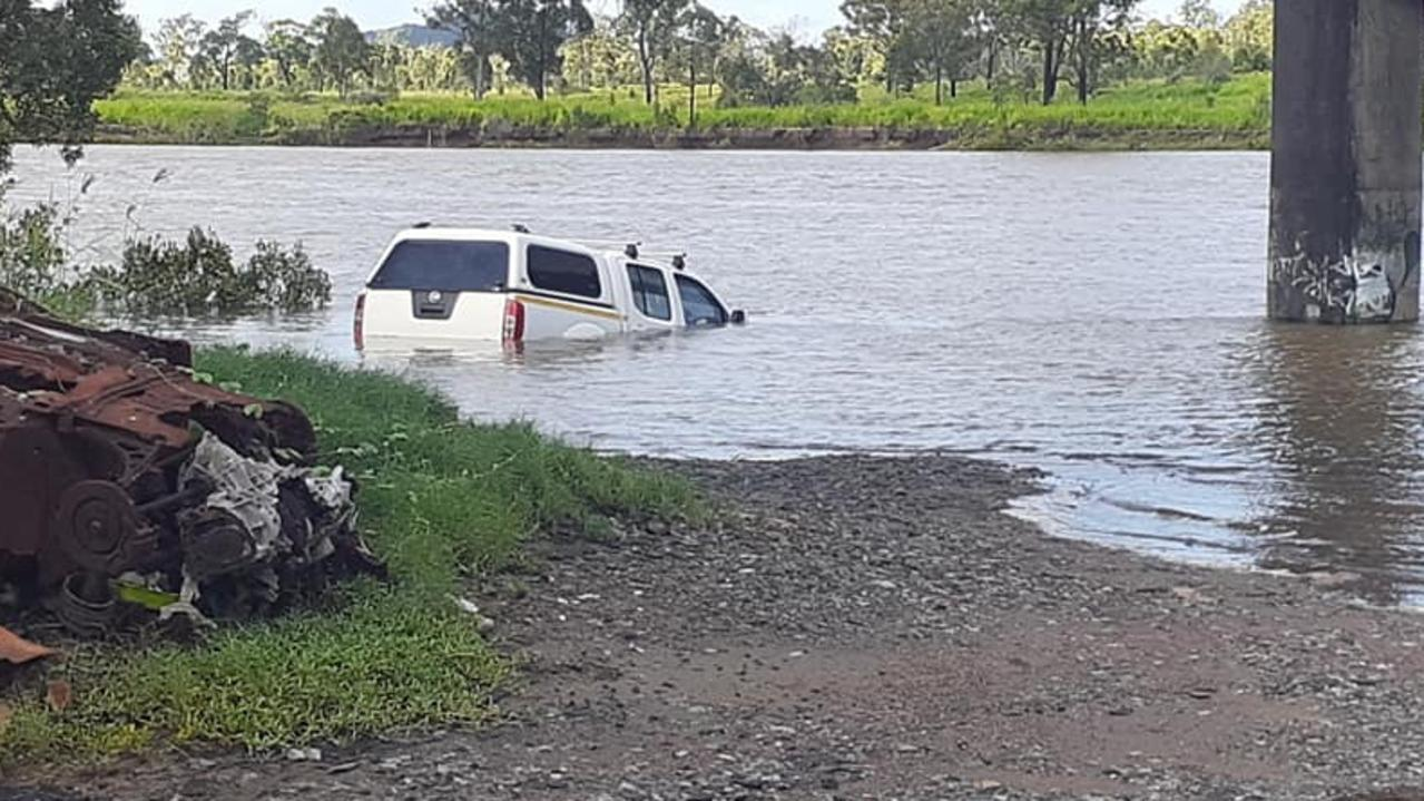 A 4WD found partially submerged in the Calliope River at about 8:35am this morning. Picture: Bradley Thoreson