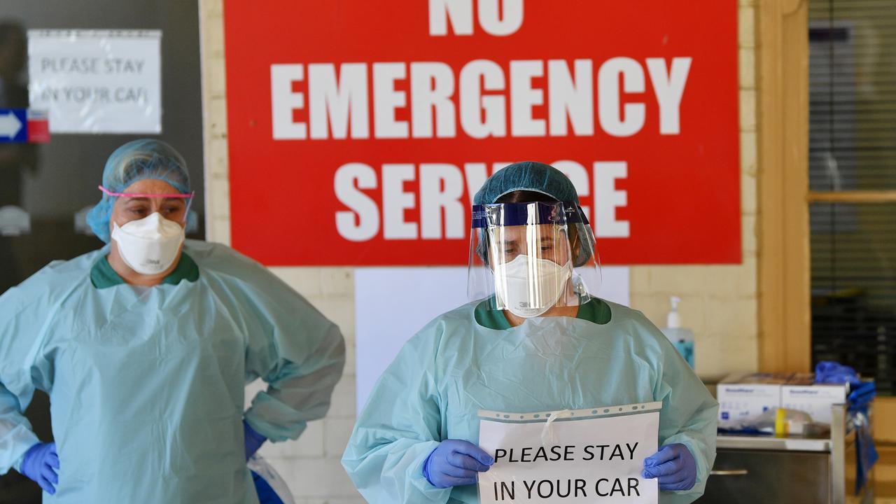 South Australia Hospital staff simulate a drive through coronavirus testing at the Repatriation Hospital in Adelaide. Picture: David Mariuz/AAP