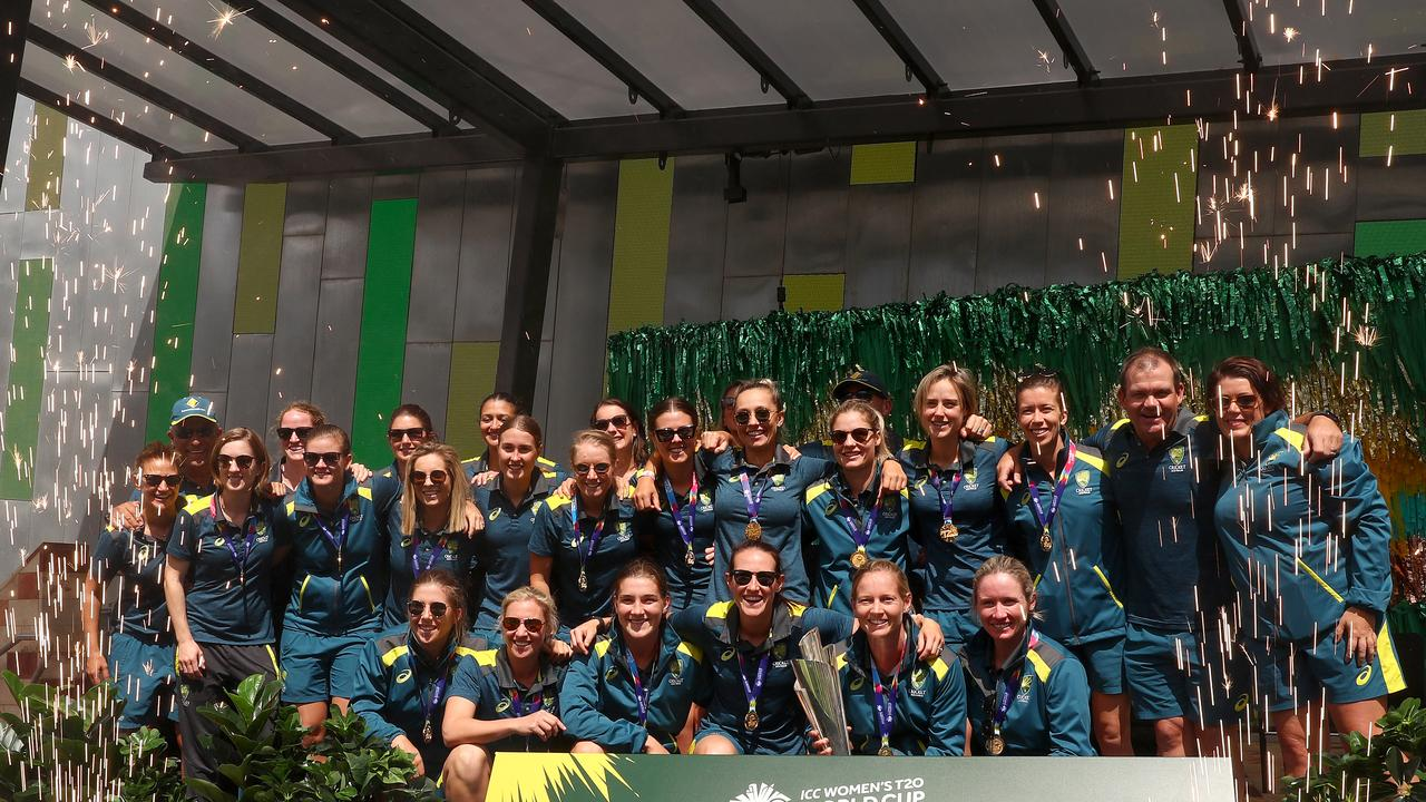 MELBOURNE, AUSTRALIA - MARCH 09: The Australian Women's T20 World Cup team celebrate after winning the ICC Women's T20 World Cup Final, at Federation Square on March 09, 2020 in Melbourne, Australia. (Photo by Kelly Defina/Getty Images)