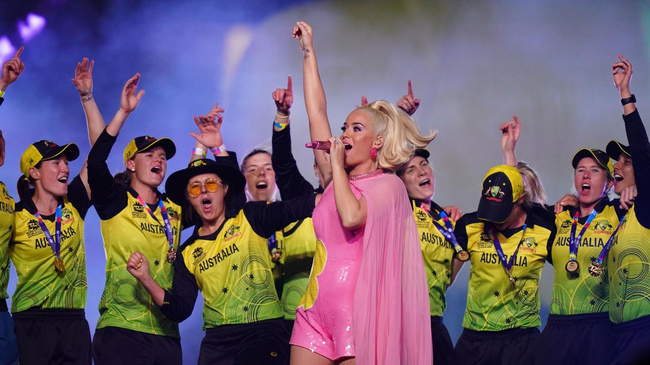 The victorious Australians celebrate on stage with pop princess Katy Perry at the MCG. Picture: AAP Image/Scott Barbour