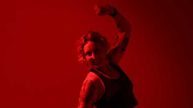 Coordinator for Dark Mojo, Jo Peillon show off some moves. Dark Mojo is an hour session where people are encouraged to dance, move and express themselves in a dimly lit environment.