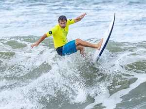 Currimundi masters surfer savours Qld title win in big waves