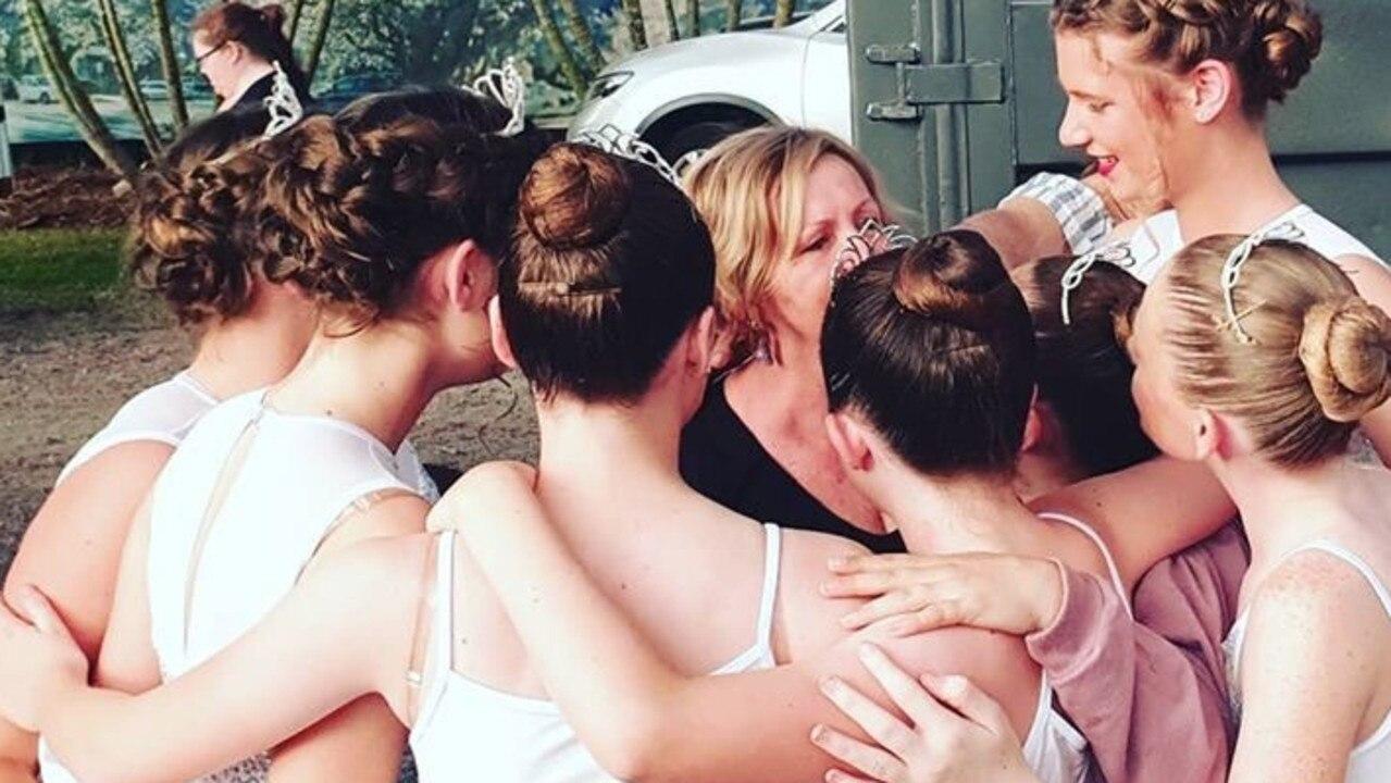 Studio One Dance Academy teacher Gail Harding gets a hug from her dancers before a performance.
