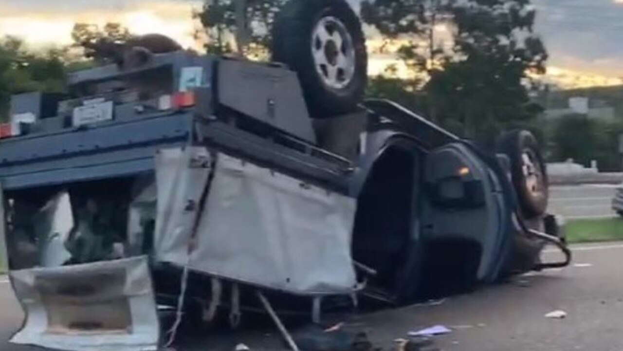 A single-vehicle rollover on the Bruce Hwy near Townsville yesterday. Picture: Facebook