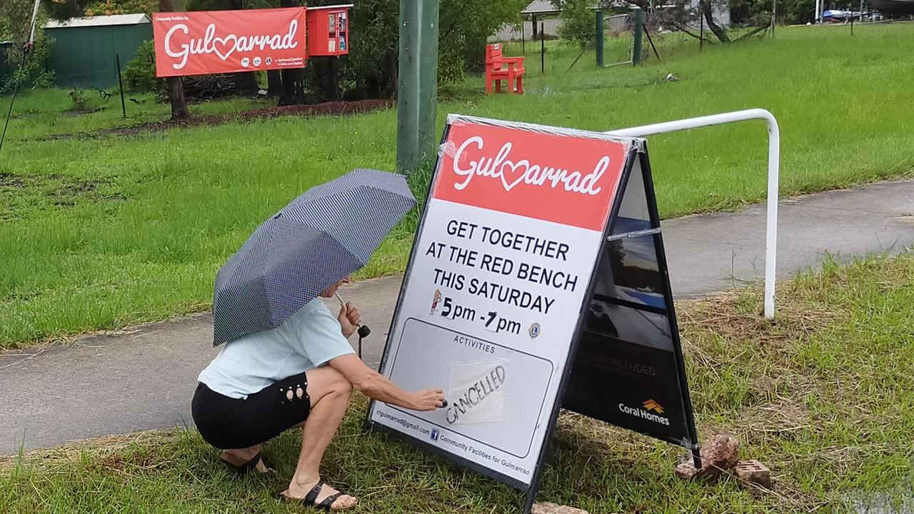 Grace Westera puts out the cancelled sign for the monthly Gulmarrad roadside meetings. The meeting will go ahead this month, with a guest speaker.
