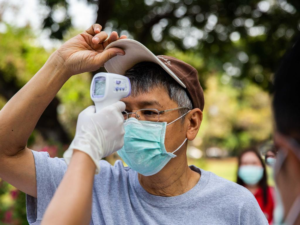 A man wearing a surgical mask correctly fitted over the nose and mouth. Picture: Getty Images