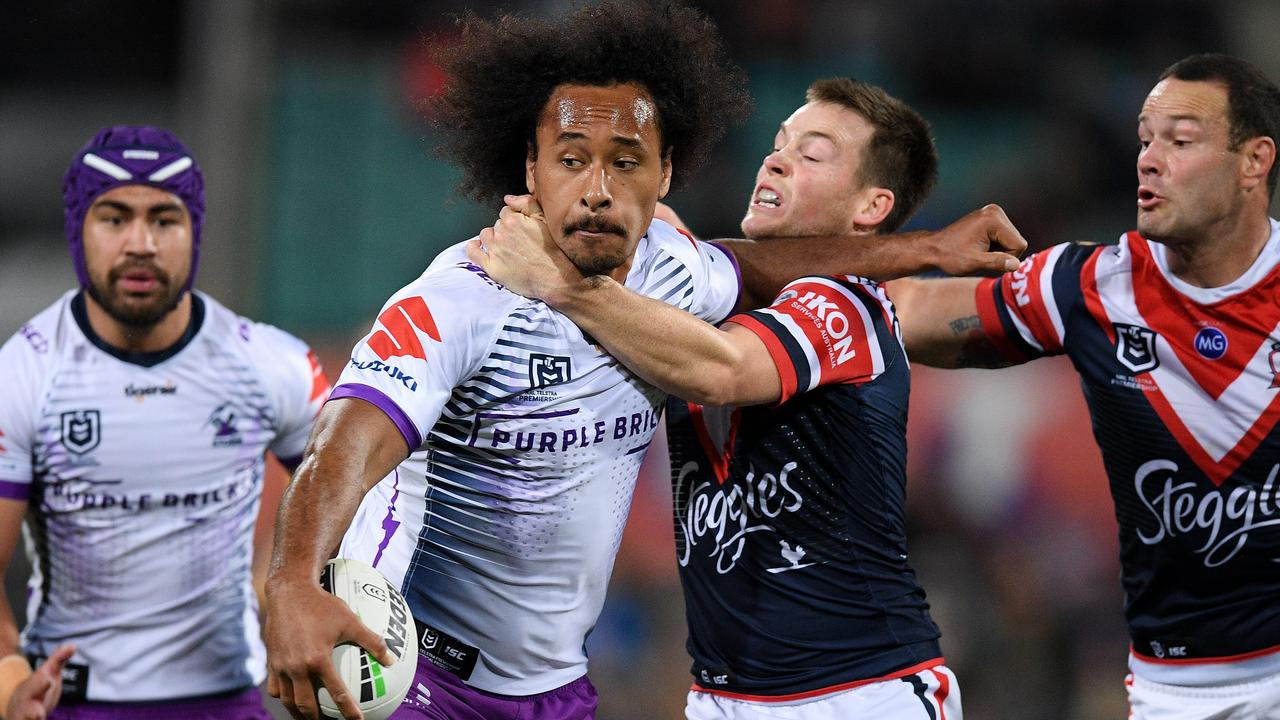Felise Kaufusi of the Storm is tackled by Luke Keary of the Roosters during the NRL Preliminary Final match between the Sydney Roosters and Melbourne Storm at the SCG in Sydney, Saturday, September 28, 2019. (AAP Image/Dan Himbrechts) NO ARCHIVING, EDITORIAL USE ONLY