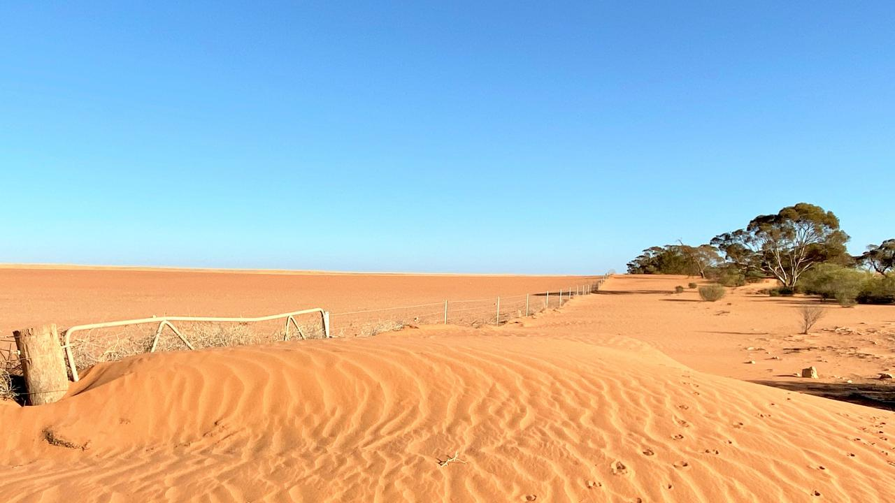 The Indian Ocean Dipole is being blamed for our extreme conditions including drought. Sand piles up against a gateway south of Werrimull in Millewa. Picture: James Wagstaff