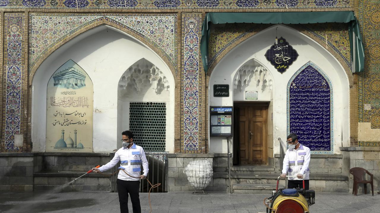 Workers disinfect the shrine of the Shiite Saint Imam Abdulazim in Tehran, Iran. Picture: AP Photo/Ebrahim Noroozi
