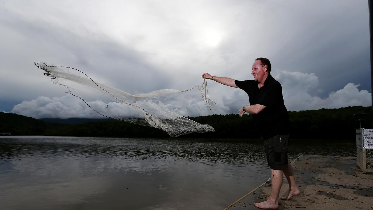 A tropical low expected to form in the Gulf of Carpentaria this week is expected to bring rain to the Far North. Ian Edwards from Bungalow gets in some casting for prawns at the Barron River boat ramp in Stratford as storm clouds build up around the city. PICTURE: STEWART McLEAN