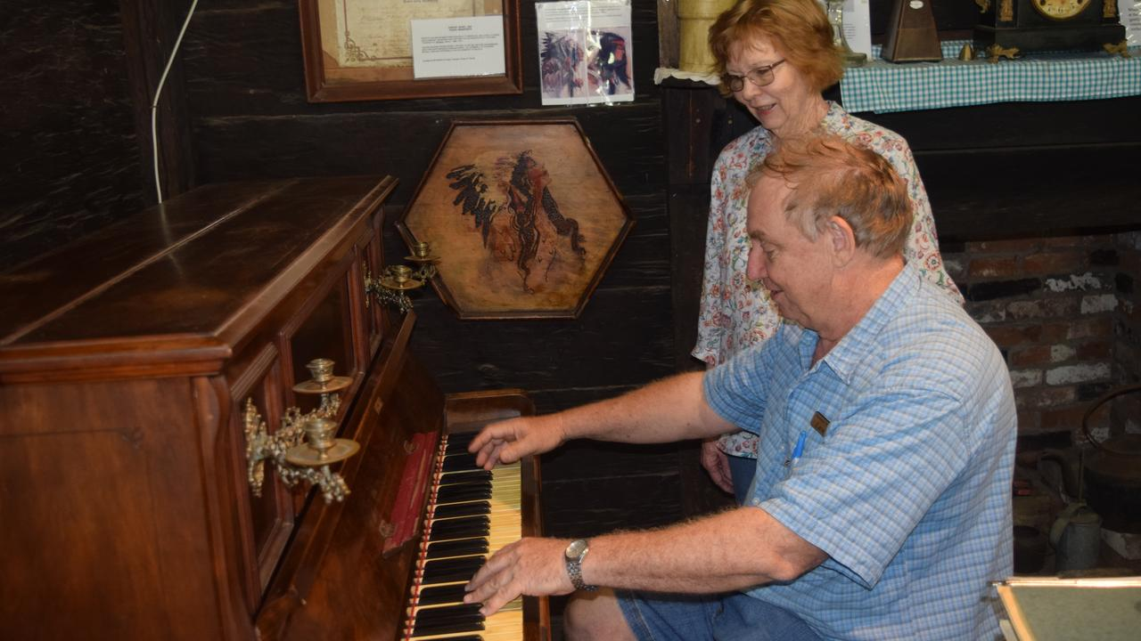 OLD TUNES: Mr Neale, with wife Fay, giving the piano keys a punch at Greycliffe Homestead.