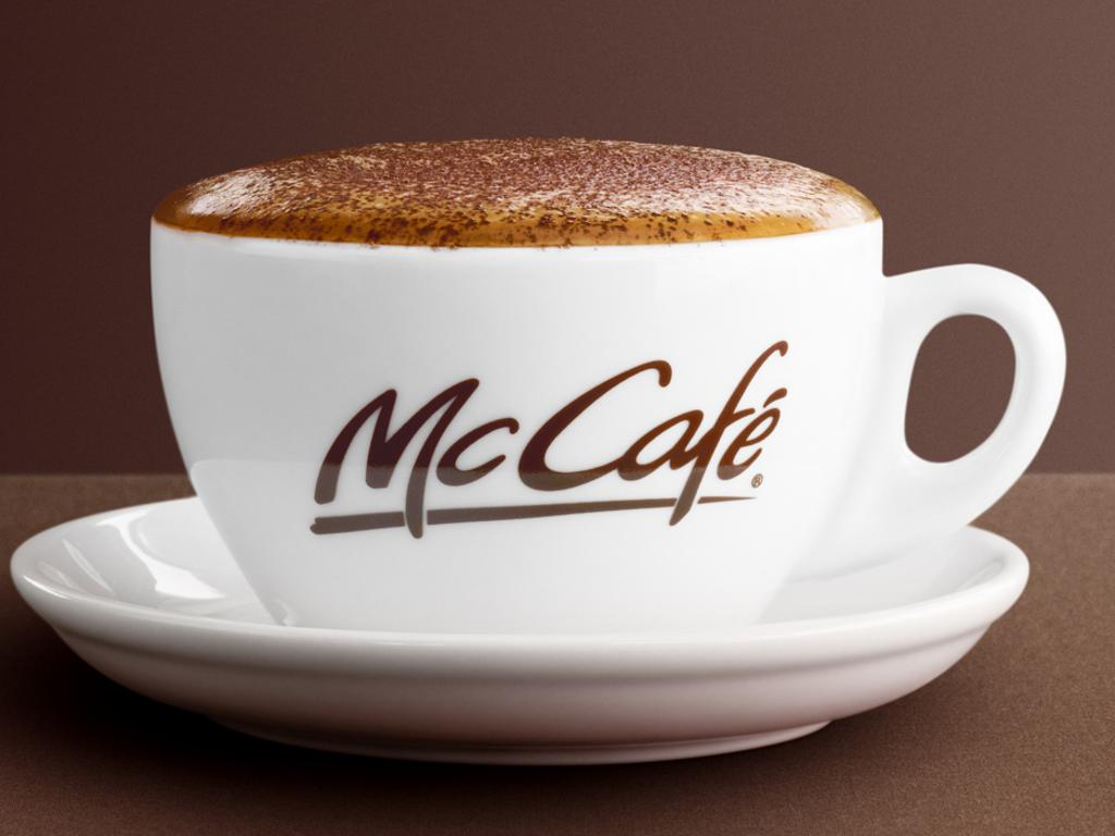 Cup of coffee cappuccino from McDonalds McCafe.