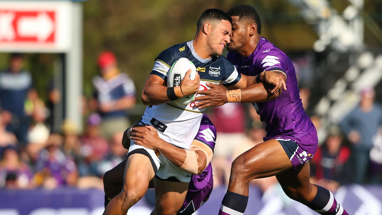 Valentine Holmes tries to shrug a tackle in the Cowboys' trial clash against the Melbourne Storm on February 29 in Melbourne. Picture: Mike Owen/Getty Images