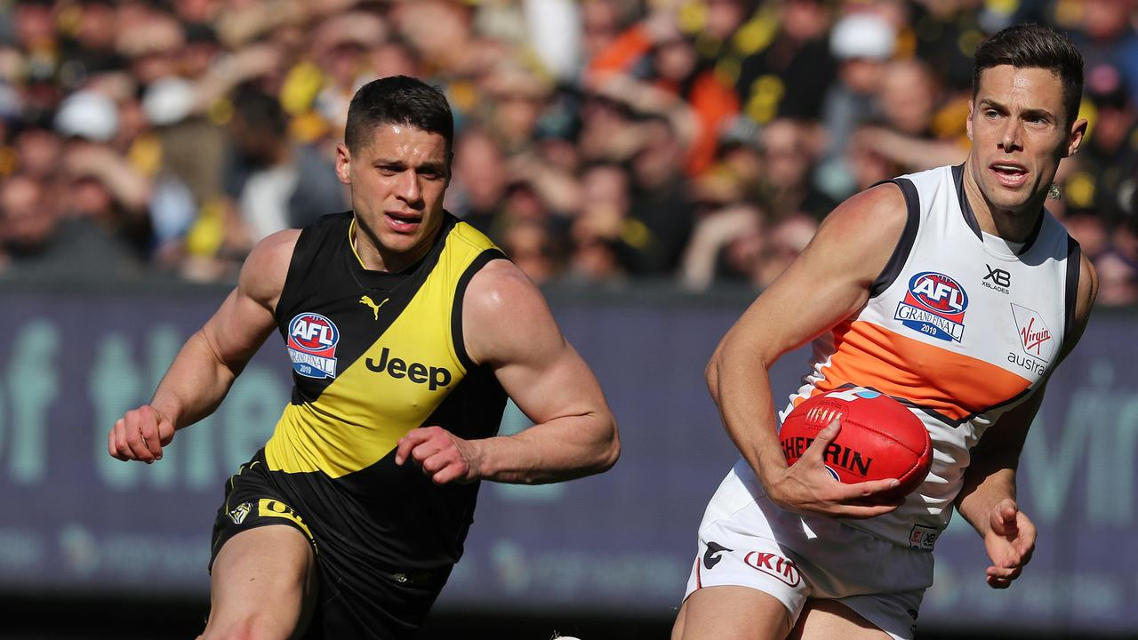 GWS star Josh Kelly eludes Dion Prestia during last year's AFL Grand Final. Picture: Michael Klein.