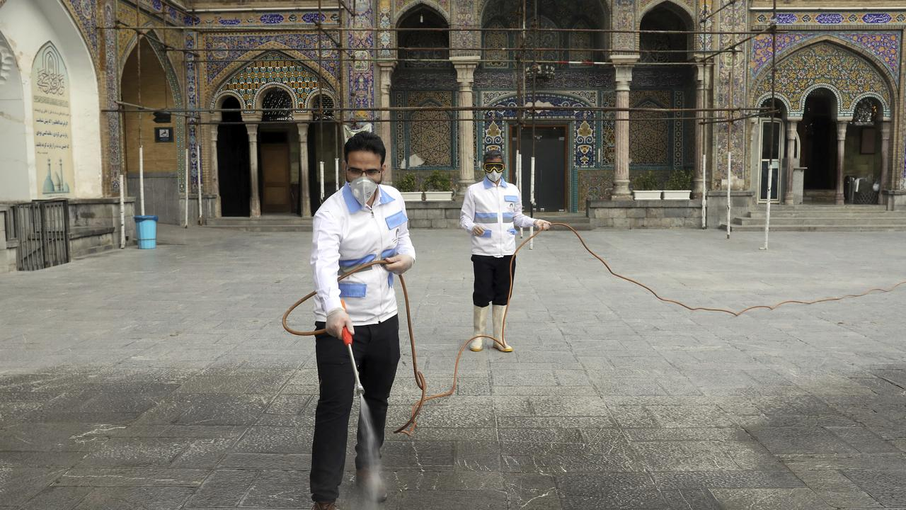 Workers disinfect the shrine of the Shiite Saint Imam Abdulazim to help prevent the spread of the new coronavirus in Shahr-e-Ray, south of Tehran. Picture: AP/Ebrahim Noroozi