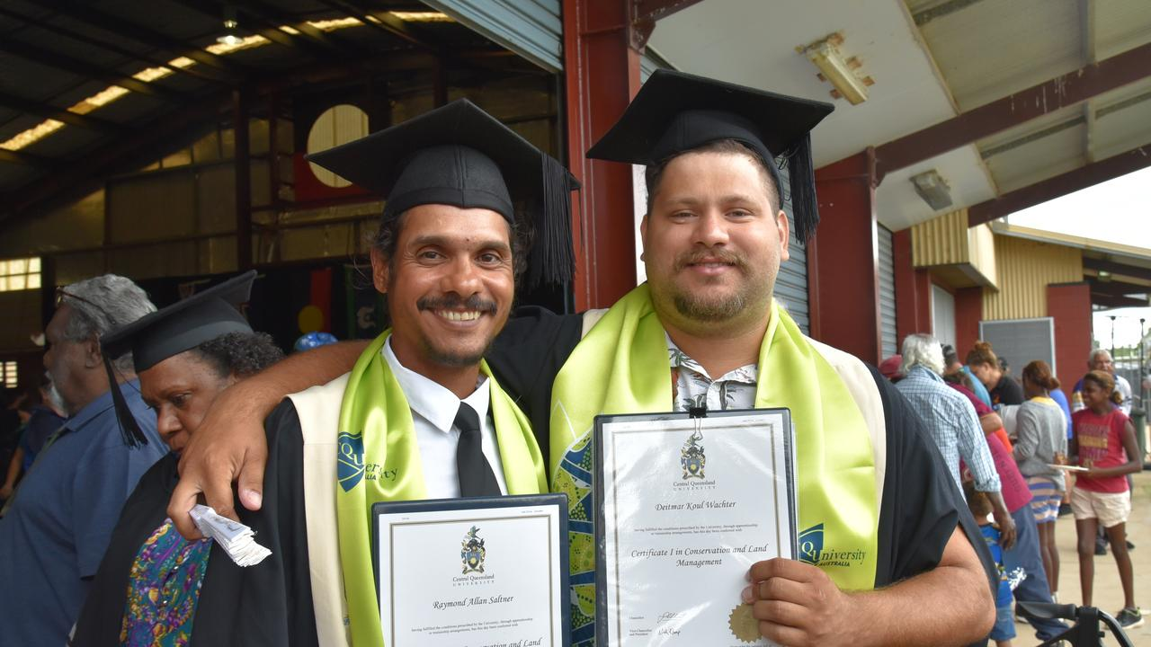 CQUniversity graduates Raymond Saltner and Deitmar Wachter proudly show off their Certificate I in Conservation and Land Management.