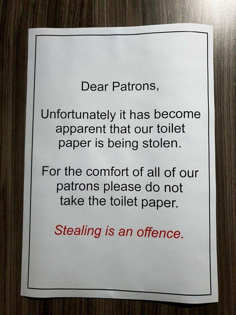 A sign asking people not to take toilet paper rolls was placed on the door of the Hervey Bay RSL toilets after thieves pinched several rolls.
