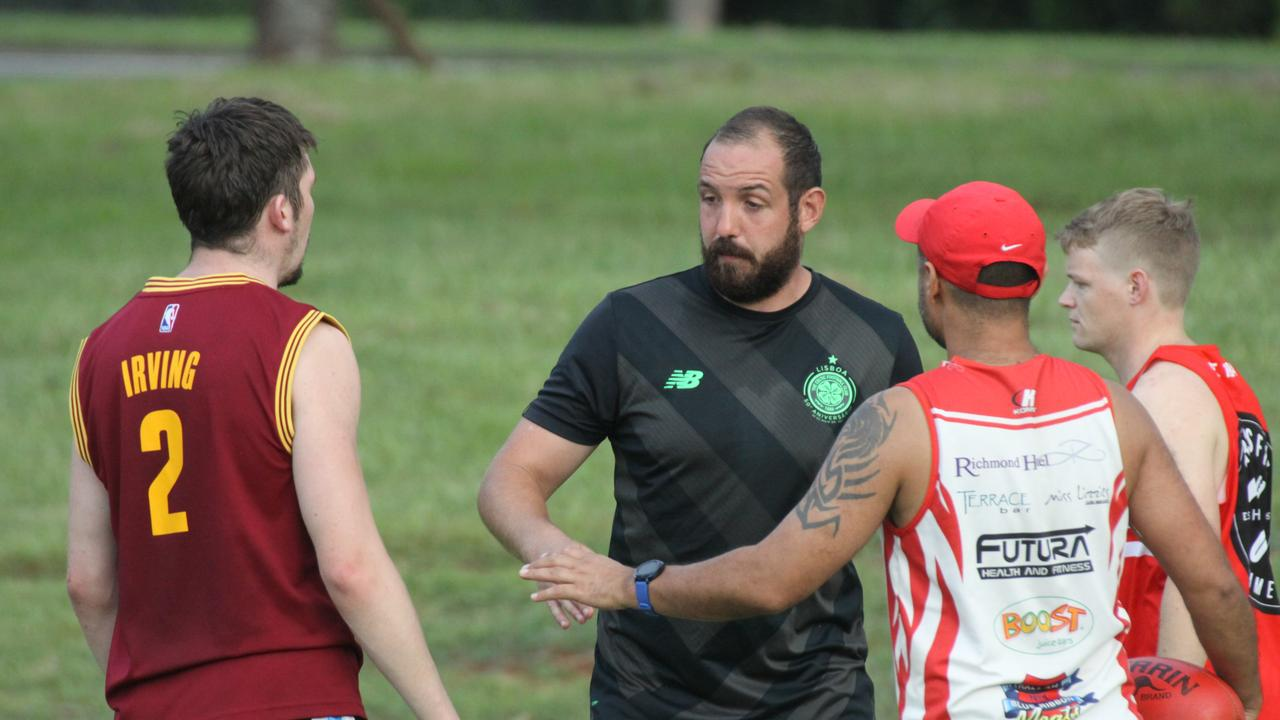 DYNAMIC DUO: Lismore Swans AFL Club seniors men's coach Joey Mitchell (red cap) said he and new captain Eoghan McNutt (in black) have formed a formidable partnership combining strategy, planning, skills and passion to ensure their players become the best possible team they can become in 2020. Photo: Alison Paterson