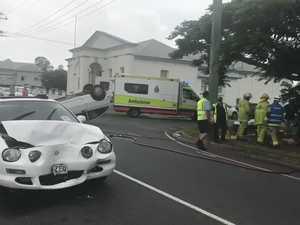 Car flips on busy Gympie street