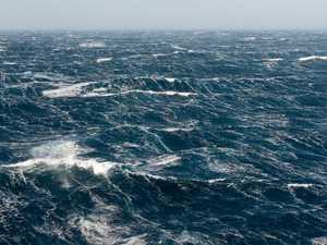 Chopper called as boat flips in stormy waters