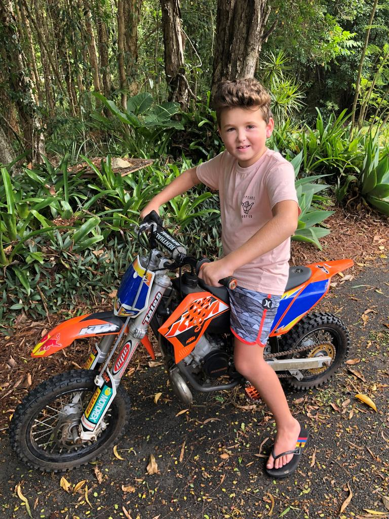 Cancer survivor Albie Batty looked forward to riding his motorbike after he finally finished treatment after two-and-a-half years. Albie is pictured on his bright-orange KTM which was stolen from his Tanawha home last week.