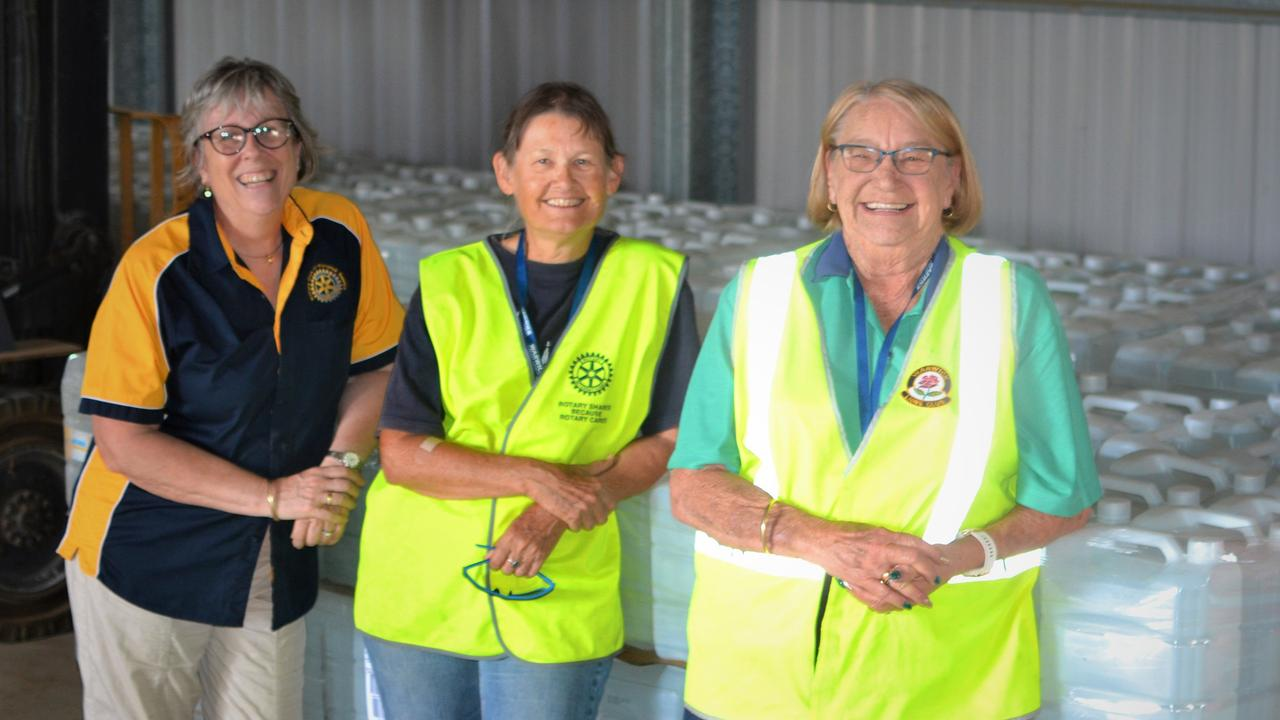 GRATEFUL FOR THE HELP: Southern Downs Community Relief Group volunteers Sally Edwards, Janet Schultz and Ros Keim help distribute drinking water.