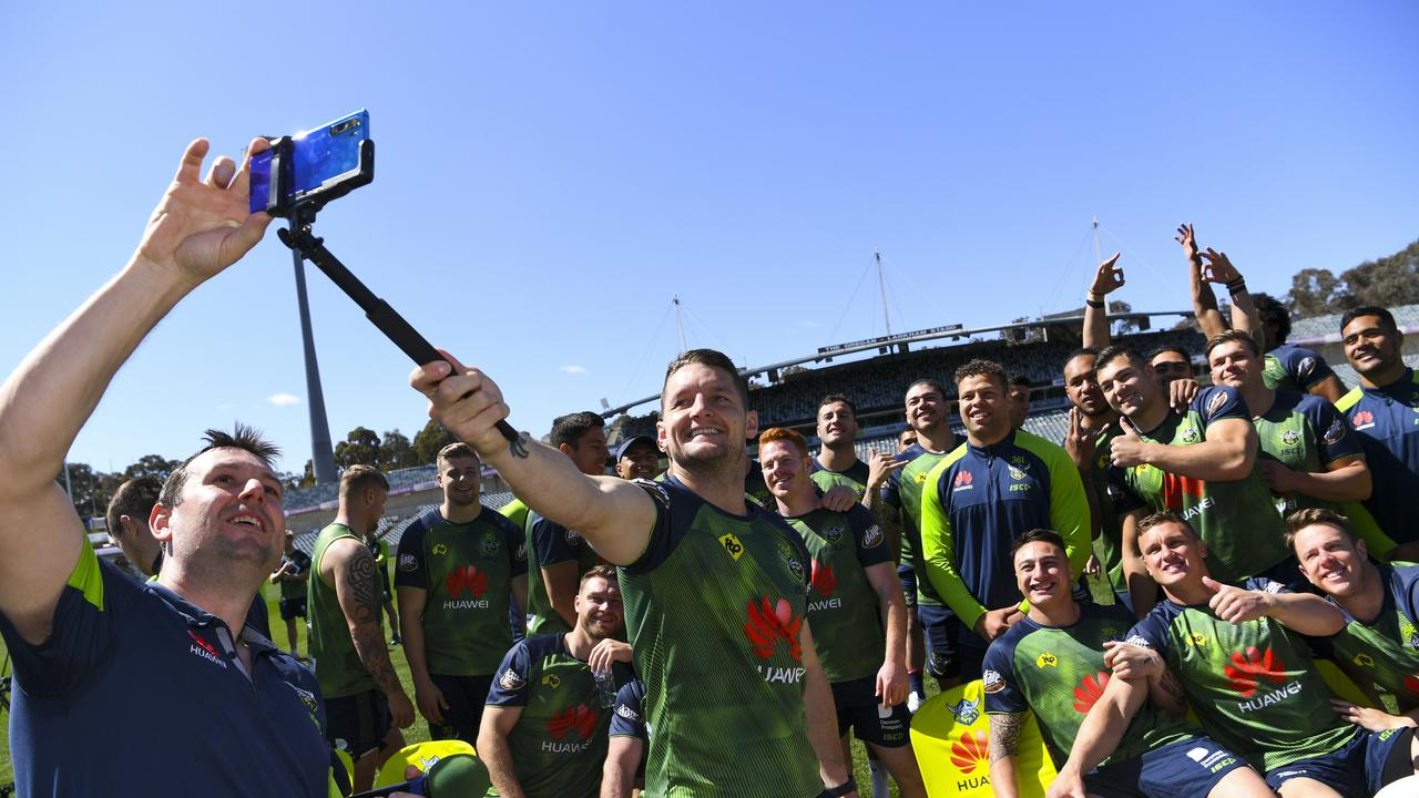 Jarrod Croker of the Raiders takes a team selfie during a training session at GIO Stadium in Canberra, Tuesday, October 1, 2019. The Canberra Raiders will face the Sydney Roosters in the NRL grand final at ANZ Stadium next Sunday. (AAP Image/Lukas Coch) NO ARCHIVING, EDITORIAL USE ONLY