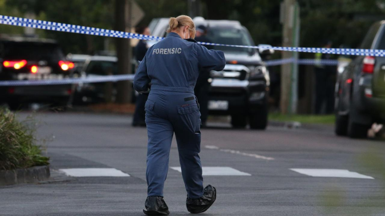 A forensic officer arrives at the scene on Walpole St in Kew, where the man was shot dead by police. Picture: David Crosling