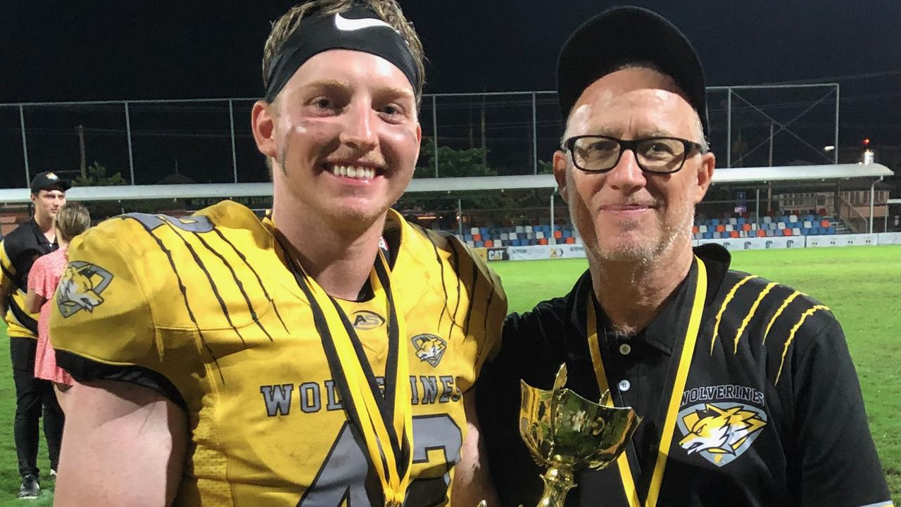 GRAND ACHIEVEMENT: Rockhampton Wolverines defensive captain Jacob Borich with his dad and coach Matthew Borich after the team's brilliant win in the North Queensland Gridiron League grand final. Picture: Pam McKay.