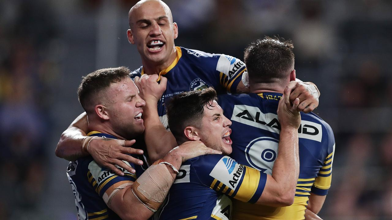 SYDNEY, AUSTRALIA – MARCH 12: Reed Mahoney of the Eels celebrates scoring a try with teammates during the round 1 NRL match between the Parramatta Eels and the Canterbury Bulldogs at Bankwest Stadium on March 12, 2020 in Sydney, Australia. (Photo by Mark Metcalfe/Getty Images)