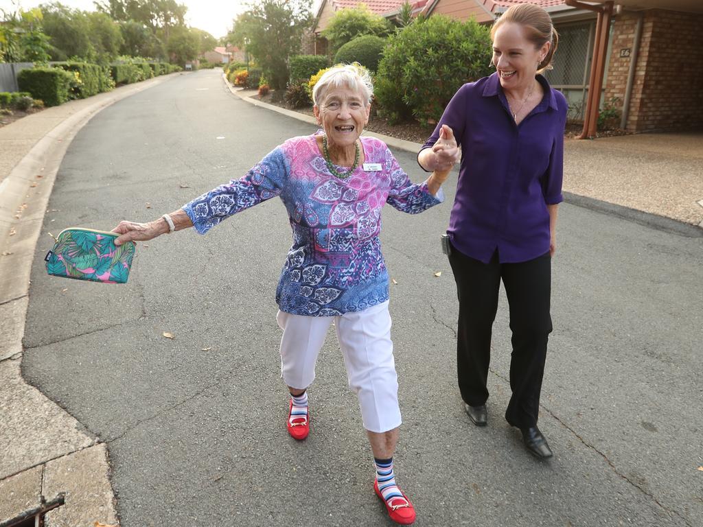 Val French on a walk with her retirement village staffer Sue Eichperger, in Upper Mount Gravatt, Brisbane, in 2017. Photo: Lyndon Mechielsen/The Australian