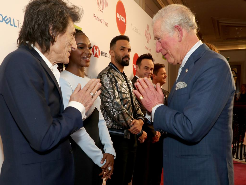 Prince Charles, Prince of Wales uses a Namaste gesture to greet Rolling Stone Ronnie Wood as he attends the Prince's Trust And TK Maxx & Homesense Awards at London Palladium. Picture: Getty