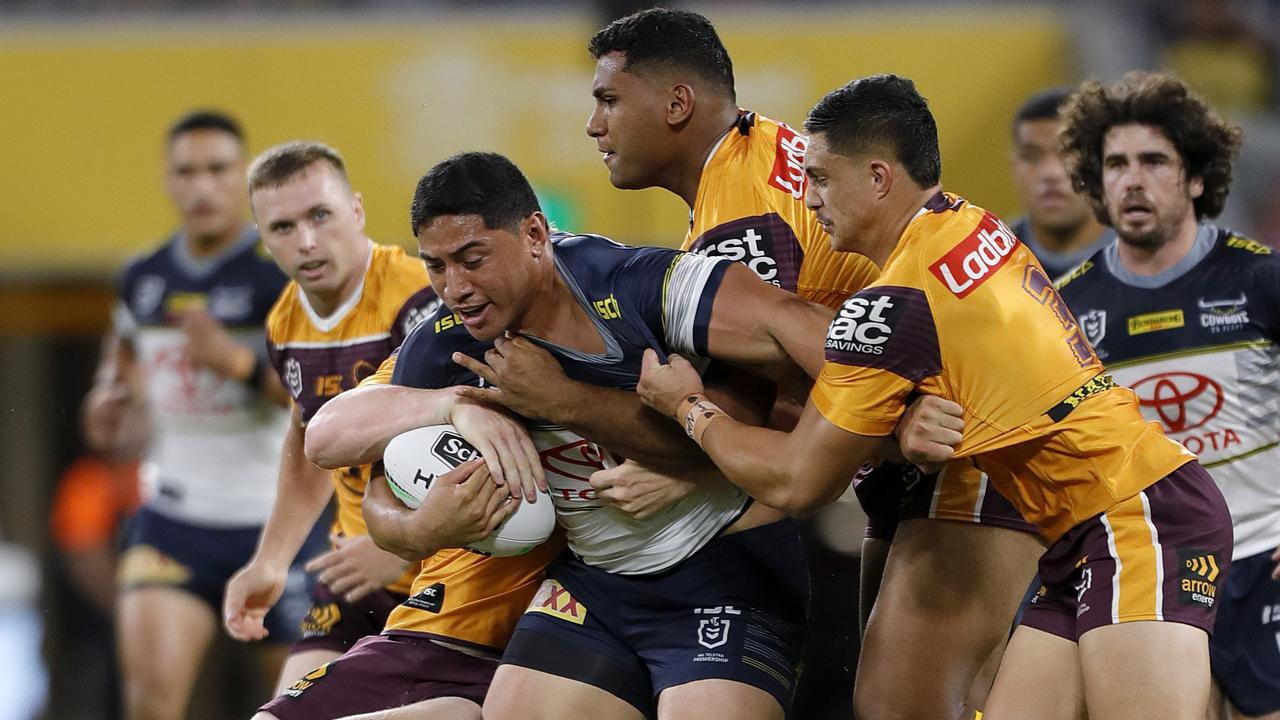 The Broncos try to stop Jason Taumalolo. Picture: AAP Image/Cameron Laird