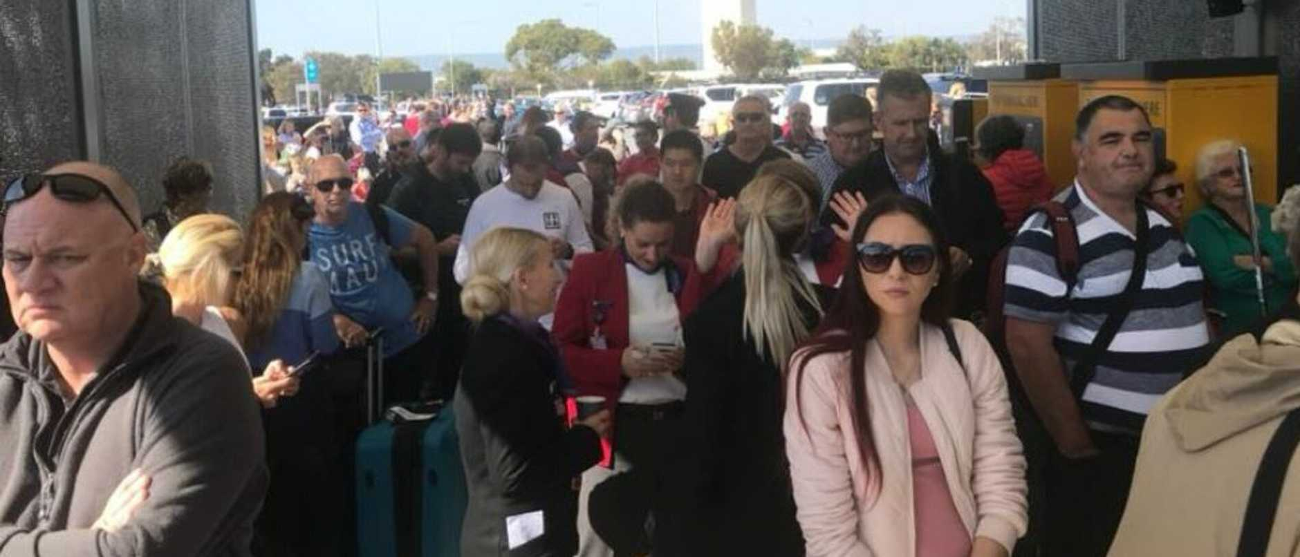 A crowd of people outside Perth airport as it is evacuated. Picture: