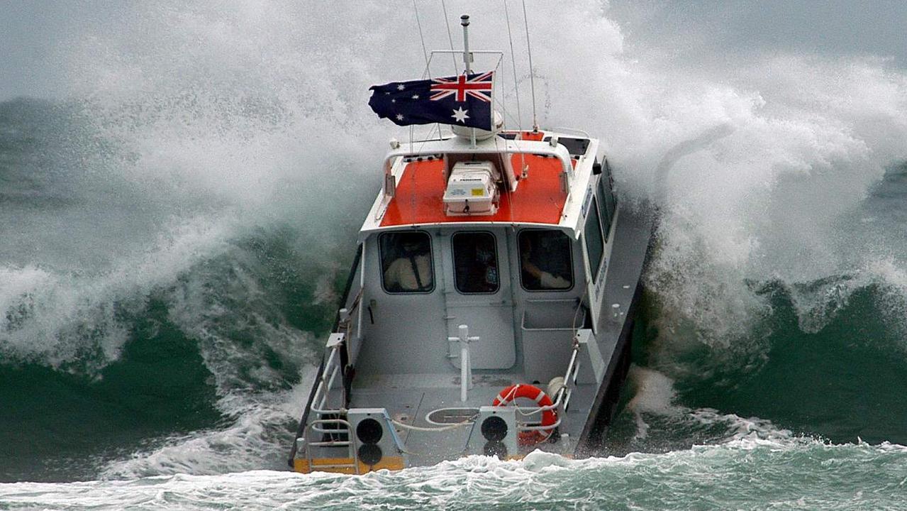 Coast Guard Noosa boat John Waddams' on the Noosa Bar in huge seas.