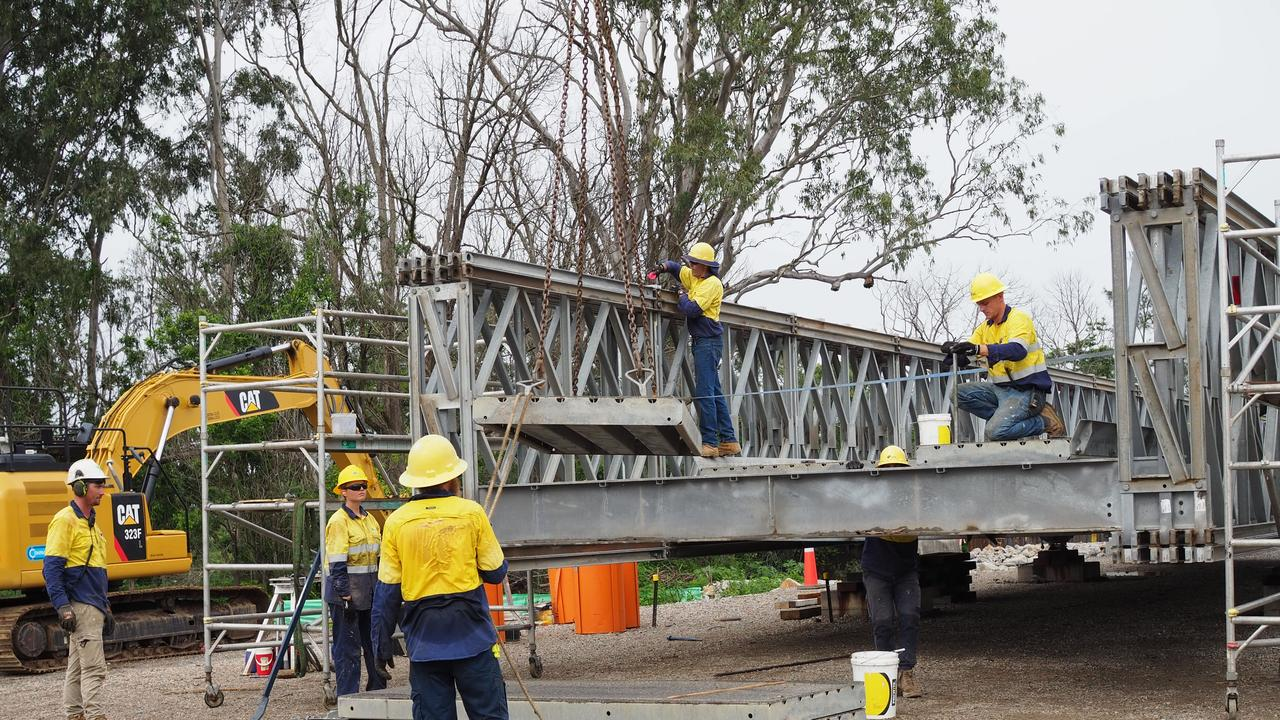 Workers put together the temporary Briner Bridge at Tucabia.