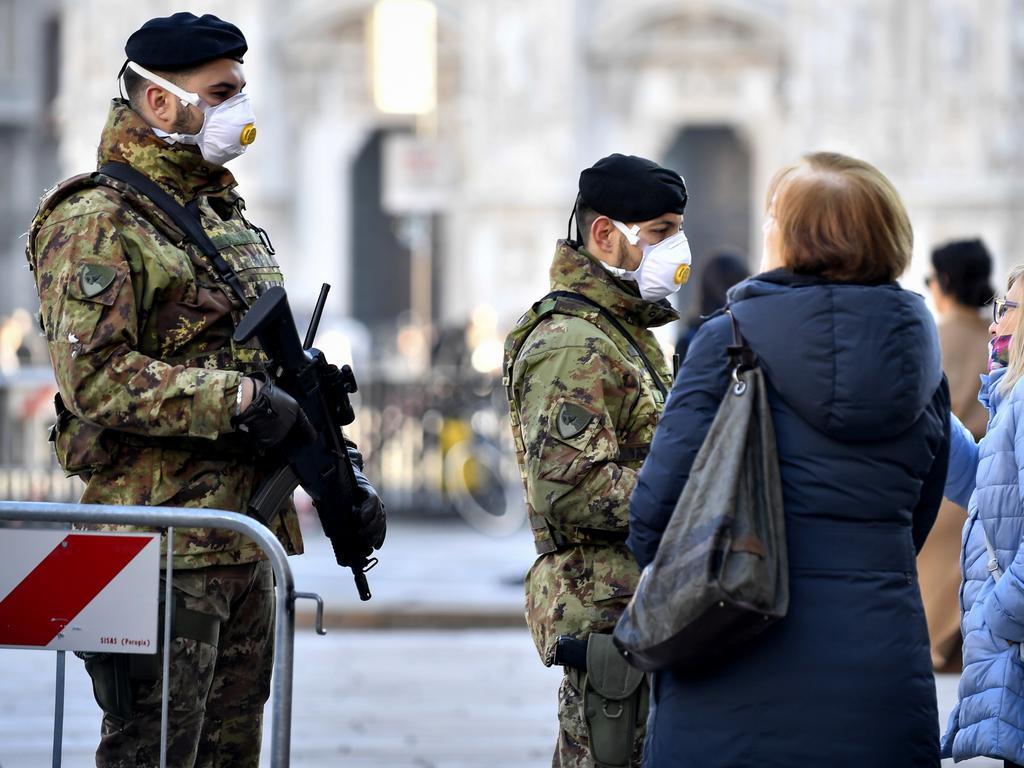 Italian soldiers wearing face masks patrol downtown Milan. Picture: Claudio Furlan/Lapresse via AP