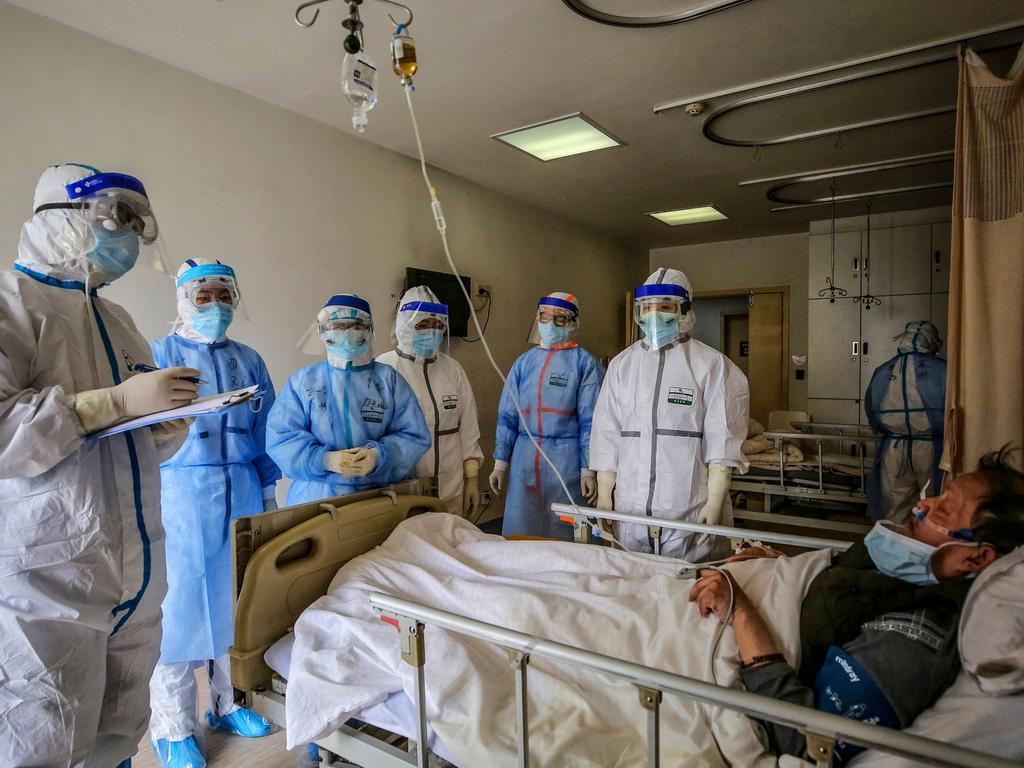 Medical staff speak with a patient infected by the COVID-19 coronavirus at Red Cross Hospital in Wuhan in China's central Hubei province. Picture: AFP