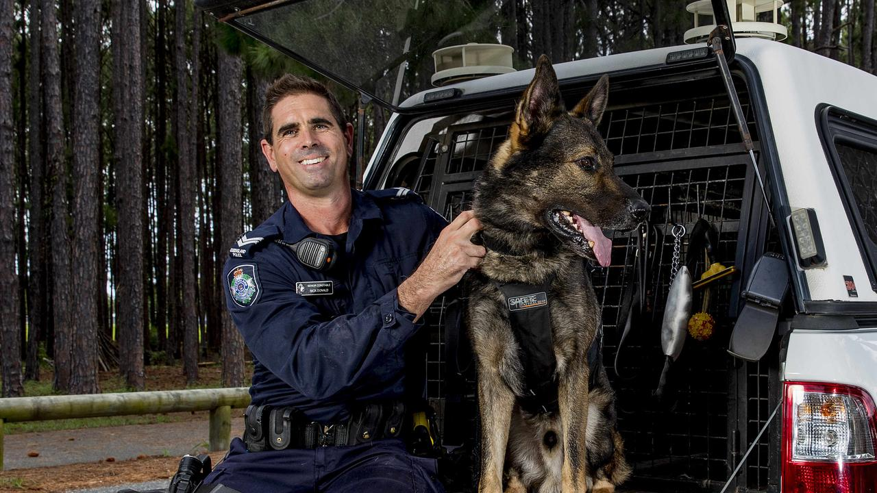 Senior Constable Nick Donald with his reliable partner PD Hondo. Picture: Jerad Williams
