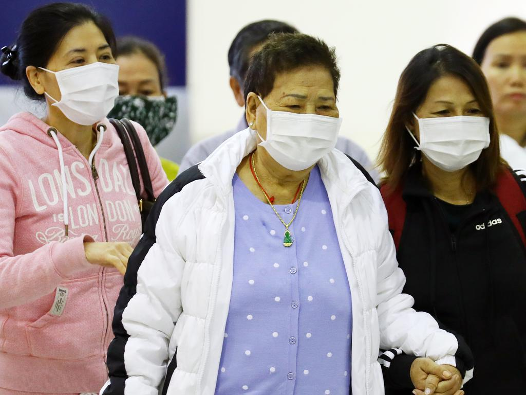 People wear masks through an airport. Picture: Matrix