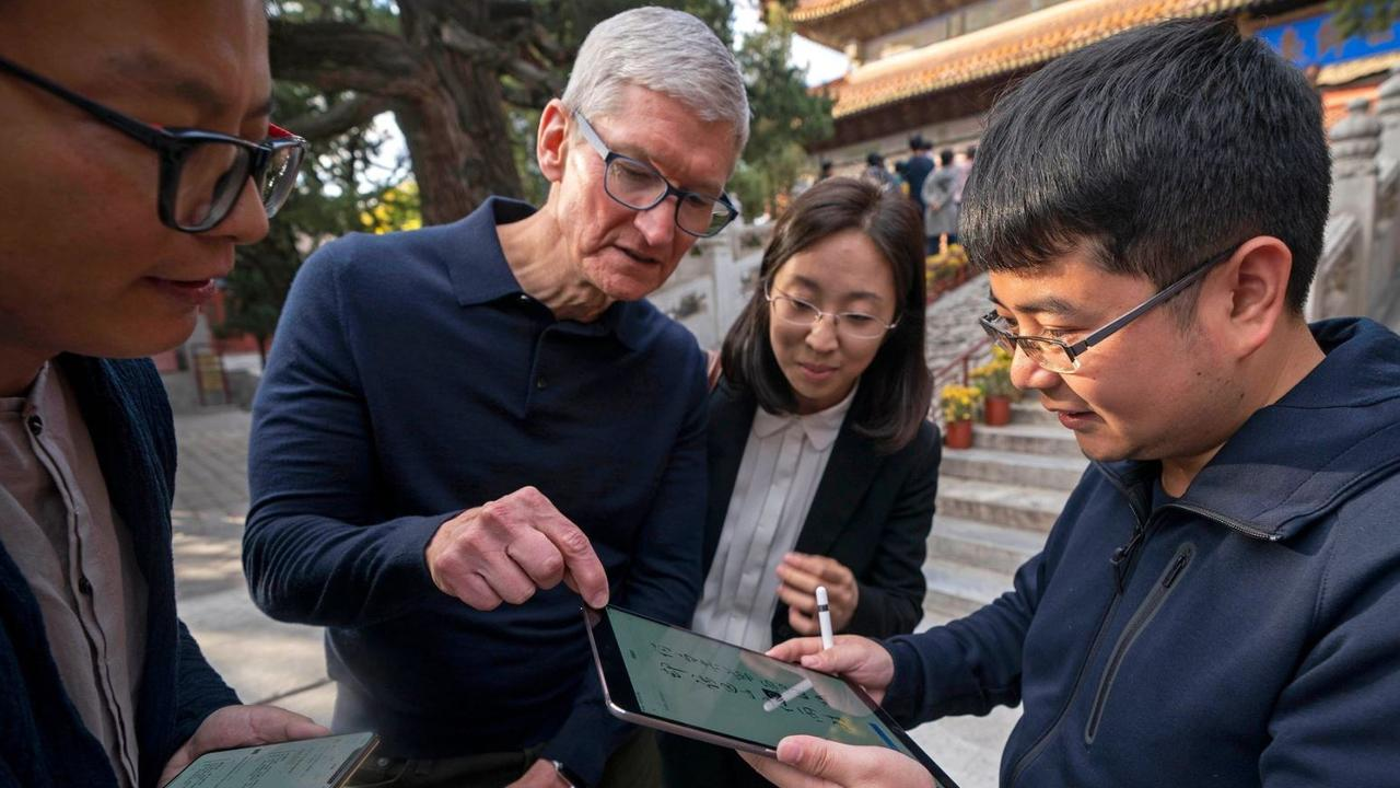 Apple chief executive Tim Cook, pictured on a visit to Beijing, said the company's Chinese stores reopened after coronavirus infections fell. Picture: CAI YANG/XINHUA/ASSOCIATED PRESS