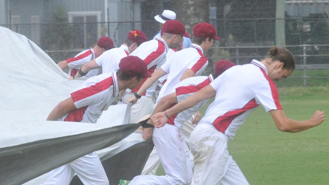 Brothers Clocktower Hotel players rush to put the covers on the wicket during a rain delay in the 2019/20 Clarence River Cricket Association GDSC Premier League minor semi-final match against Jacaranda Hotel Westlawn/GDSC Easts at McKittrick Park on Sunday, 16th March, 2020.