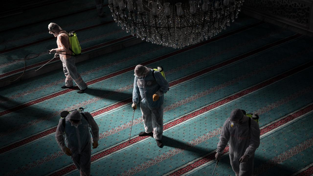 Workers from Istanbul Municipality disinfect a mosque to prevent the spread of the coronavirus ahead of Friday prayers on March 13, 2020 in Istanbul, Turkey. Picture: Chris McGrath/Getty Images
