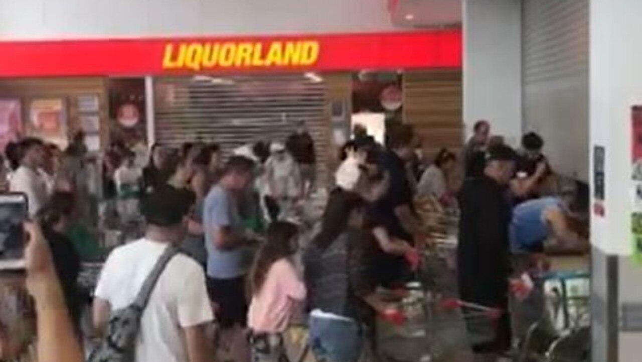 Shoppers crawl under doors as Gold Coast supermarket opens.