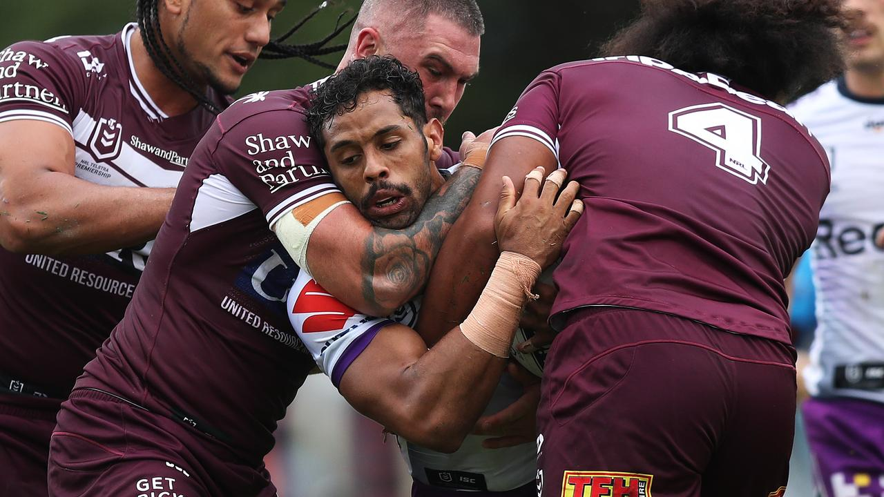 Melbourne's Josh Addo-Carr is tackled during the Manly Sea Eagles v Melbourne Storm NRL match at Lottoland, Brookvale. Picture: Brett Costello
